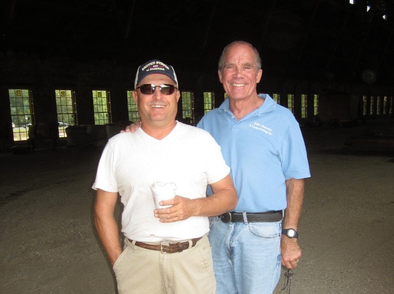 The Masons of AAA-1 Masonry & Tuckpointing: Howard Reese (right, in blue shirt) served as owner until 2004 when responsibilities passed to his son, Robert. After a 30-year tenure, Howard continues to meet with clients, draft scopes of work, and explain the craft to clients.