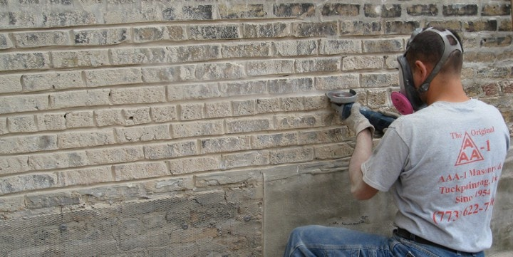 Grinding mortar on one knee