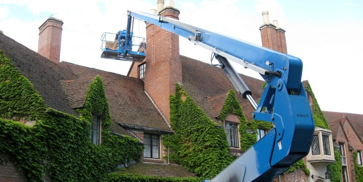 A complicated chimney restoration project in Lake Forest.  Numerous pitched roof lines and beautiful landscaping below the work area necessitated the use of an articulated boom lift.