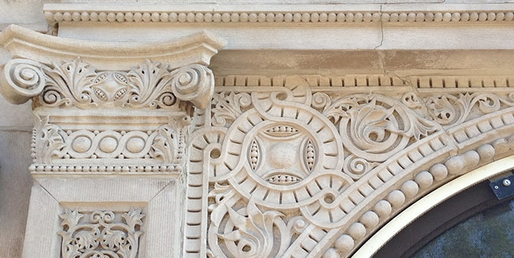 Intricate decorative details above a window
