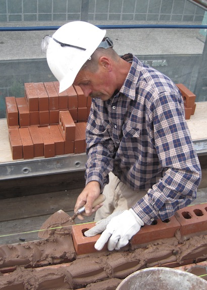 AAA-1 licensed mason Bogdan laying bricks
