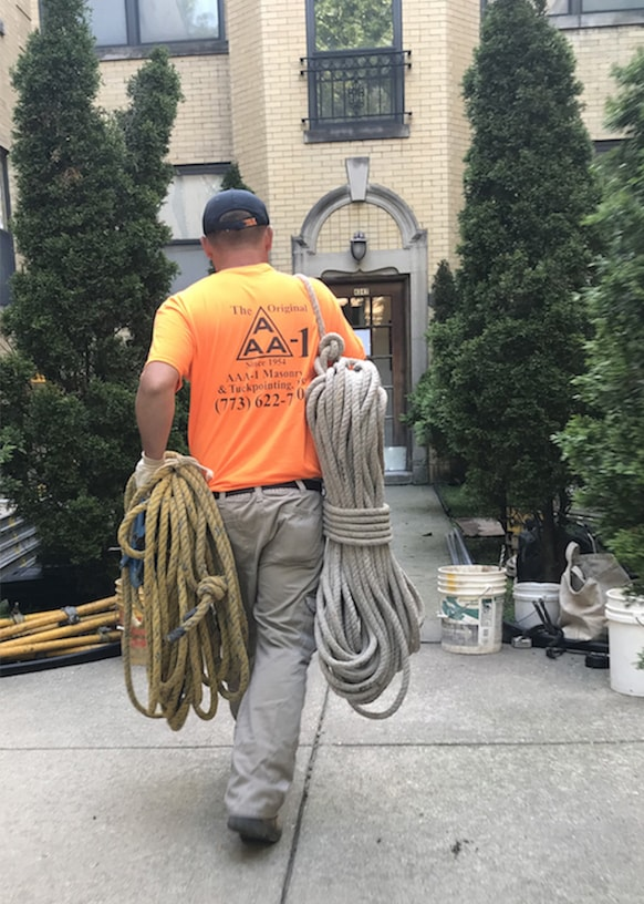 AAA-1 licensed mason carrying rope
