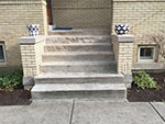 Limestone entryway steps with stoop walls rebuilt using original 95-year-old capstones and footers.