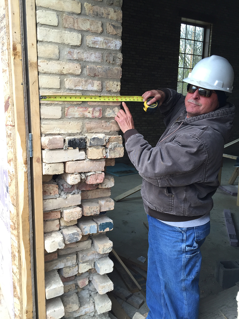 A member of our team measures out a four-wythe door jamb.