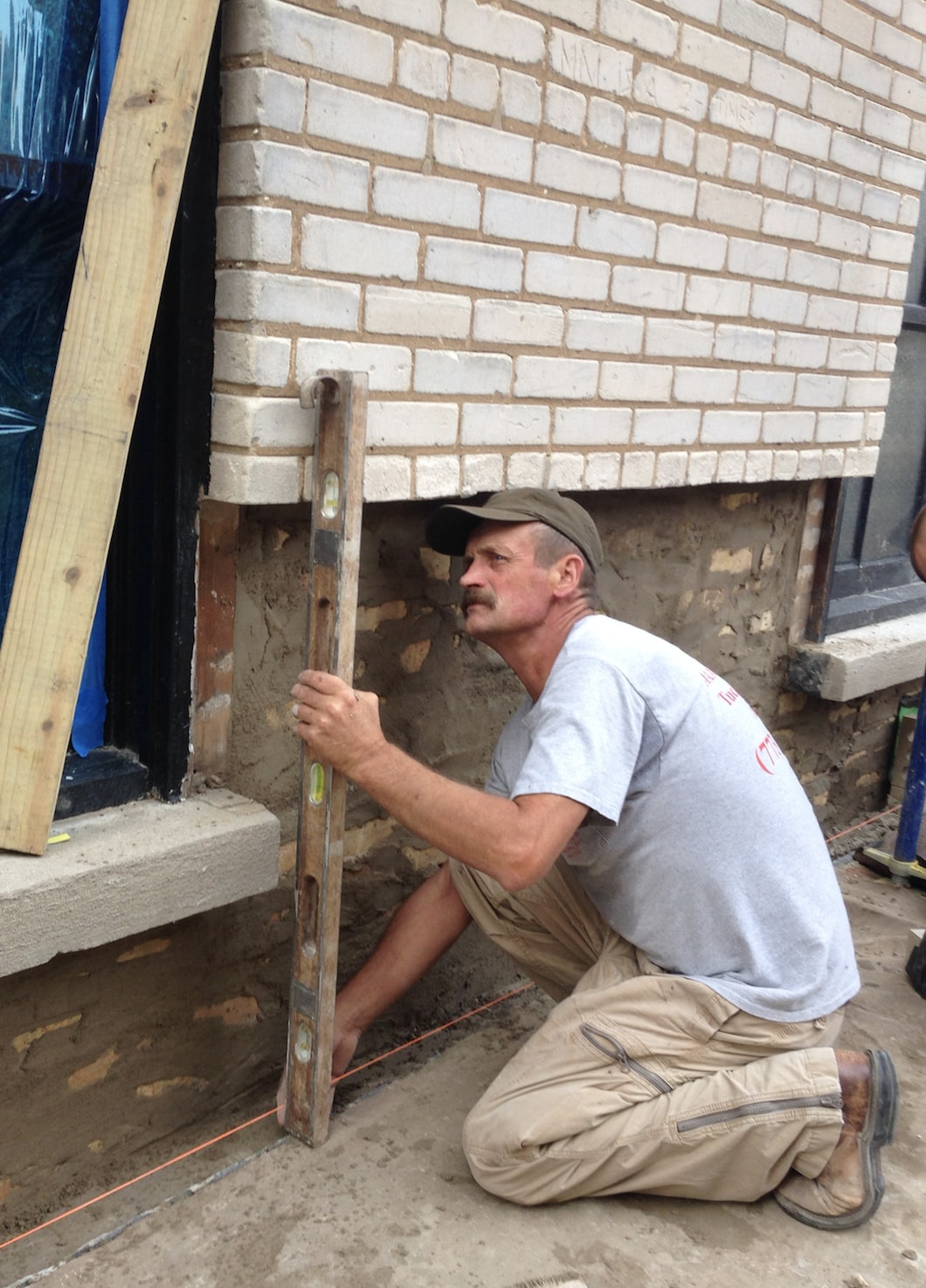 A licensed mason checking for plumb and level
