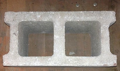 A hollow concrete / split face block