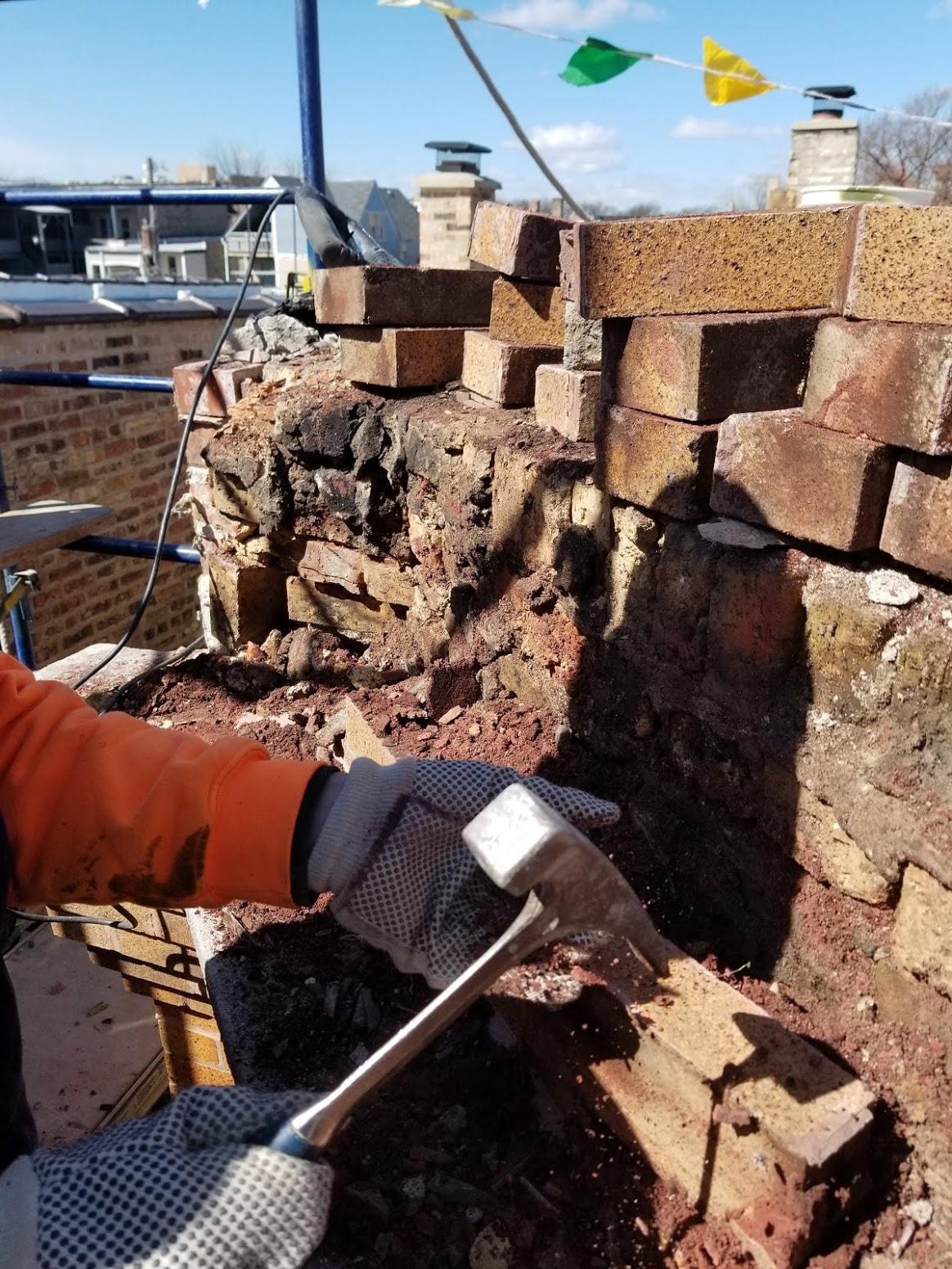A mason shows the powdery mortar