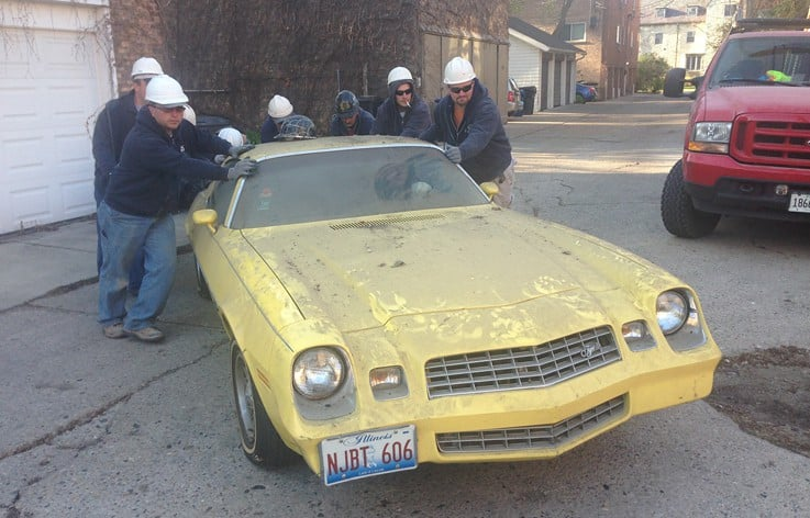 AAA-1 licensed masons pushing a 1975 Pontiac TransAm